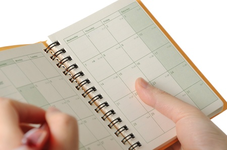 inform information: Business woman making appointment on notebook
