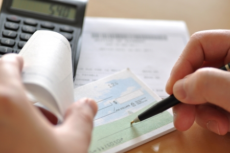 pay bills: Prepare writing a check to pay bill Stock Photo