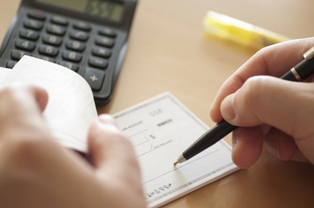 Business man writing a check photo