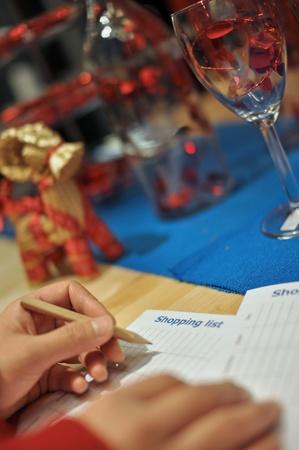 Woman writing shopping list for xmas season  photo