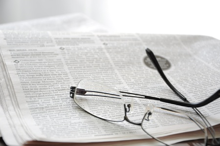 Newspaper and the glasses Stock Photo - 11472551