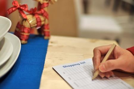 Writing shopping list for xmas season  photo