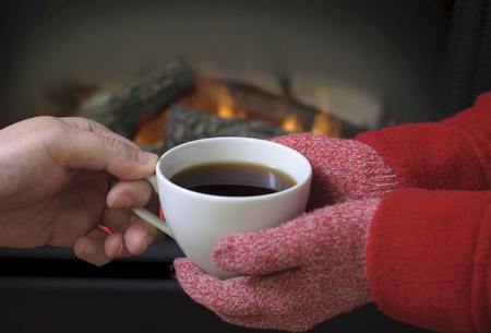 Hand warming at a fireplace Stock Photo