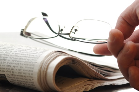 reading material: Newspaper and eyeglasses Stock Photo