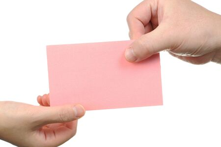 Businessman handing empty pink business card photo