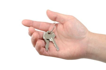Business man holding key for your new home Stock Photo - 11838141