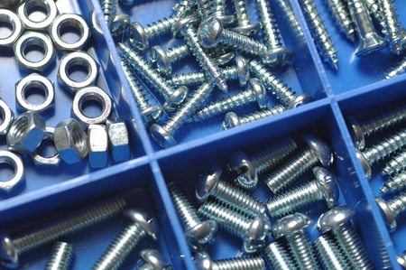 Nut and bolt in blue box Stok Fotoğraf
