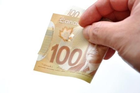 Handing new one hundred bill on white background Archivio Fotografico