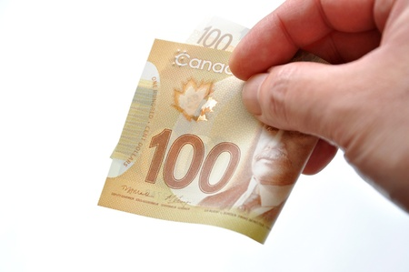 Handing new one hundred bill on white background photo