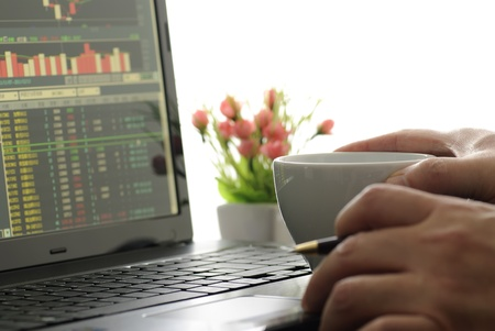 Business man checking stock diagram in office  photo