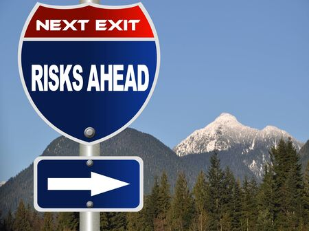 risks ahead: Risks ahead road sign