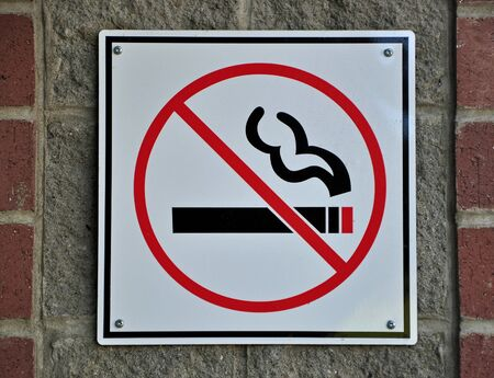 No smoking sign on wall photo