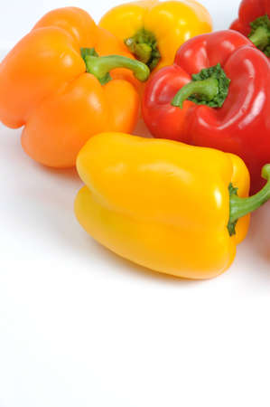 Fresh colorful bell peppers on white background