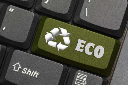 energy work: Recycle symbol on a Computer keyboard