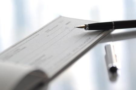 Prepare writing a check  Stock Photo