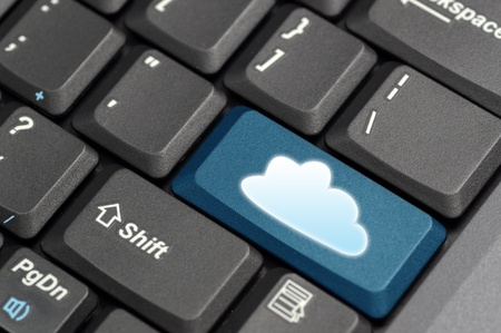 Cloud computing concept showing cloud icon on computer key Stock Photo - 12900019