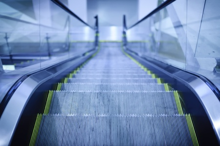 Moving Escalator with blue toned color photo