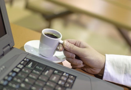 expresso: Woman drinking an expresso coffee  Stock Photo