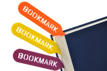 Colorful bookmarks your book on white photo