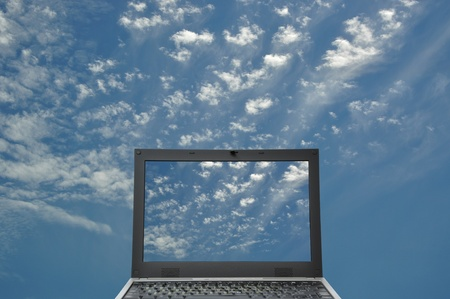 Black laptop on blue sky concept photo