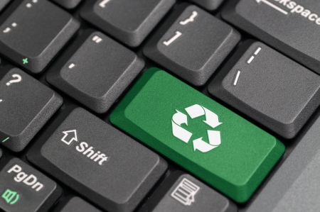 Recycle sign on a laptop photo