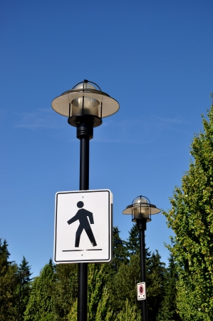 Pedestrian road sign with road lamp