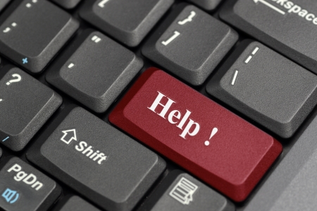 Red help key on laptop Stock Photo - 14428910