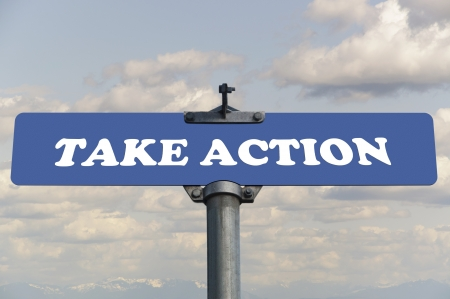 take action: Take action road sign Stock Photo