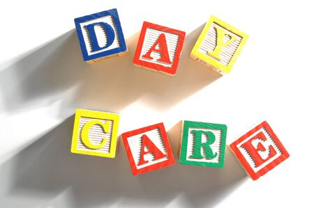 Alphabet Blocks spelling the words day care Stock Photo - 15477929