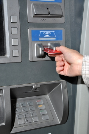 Withdraw money from ATM machine  photo