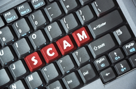 web scam: Red scam word on computer keyboard