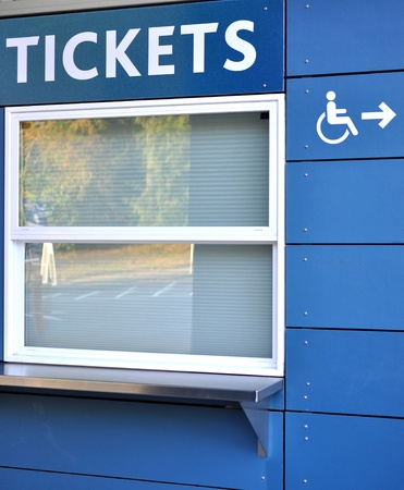 Tickets sell window with disable access sign photo