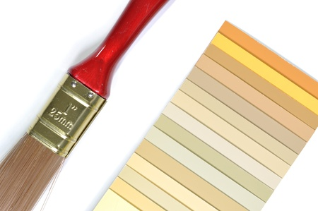 Sample colors catalogue and paint brush photo