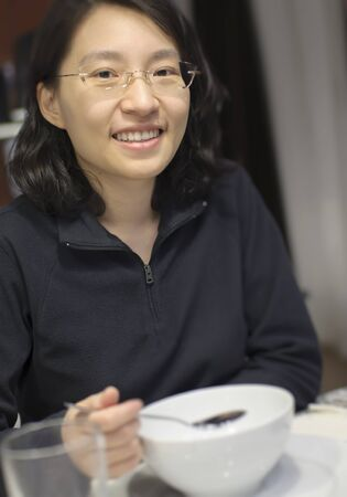 Woman drinking soup at restuarant photo