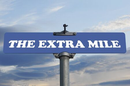 mile: The extra mile road sign Stock Photo