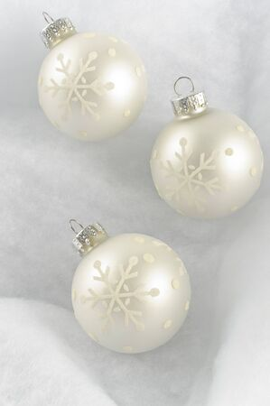 three wishes: Pure Christmas ball on white background  Stock Photo