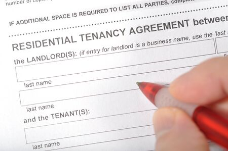 Man signing a rental contract  photo