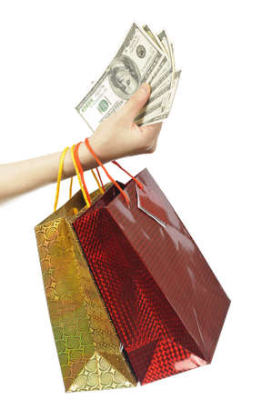 Hand with shopping bags and money photo