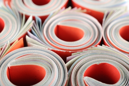 Rolled magazine background  Stock Photo - 16959729