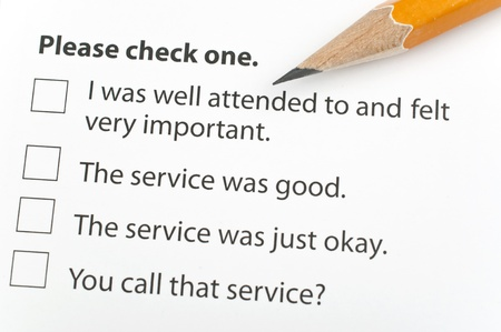 Customer survey form with pen