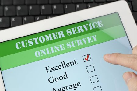 Online customer service satisfaction survey on a digital tablet photo
