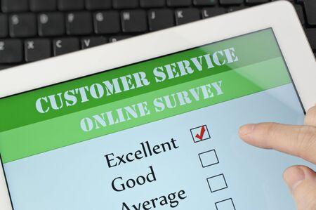 customer: Online customer service satisfaction survey on a digital tablet