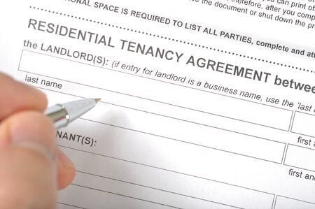 Man prepare to sign residential tenancy agreement  photo