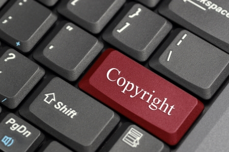 Red copyright key on keyboard Stock Photo - 17747038