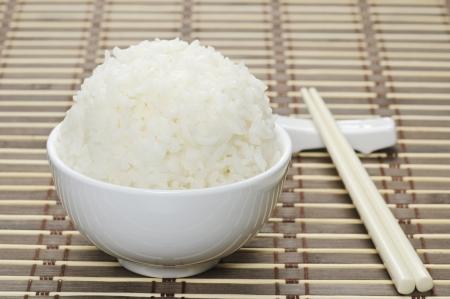 White steamed rice in ceramic bowl and chopsticks  Archivio Fotografico