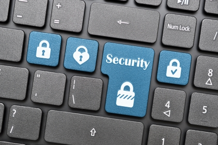 Blue security key on keyboard Stock Photo - 17888988