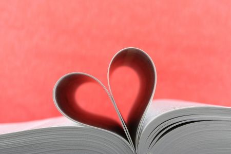 Loving books;pages of book curved into a heart shape  photo