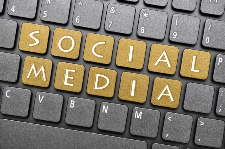 Gold social media key on keyboard Stock Photo - 17889216