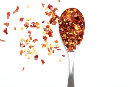spicy chilli: Crushed chillies on white background