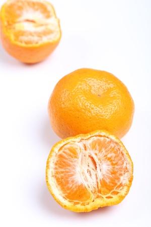 Orange mandarin or tangerine fruit isolated on white background Imagens